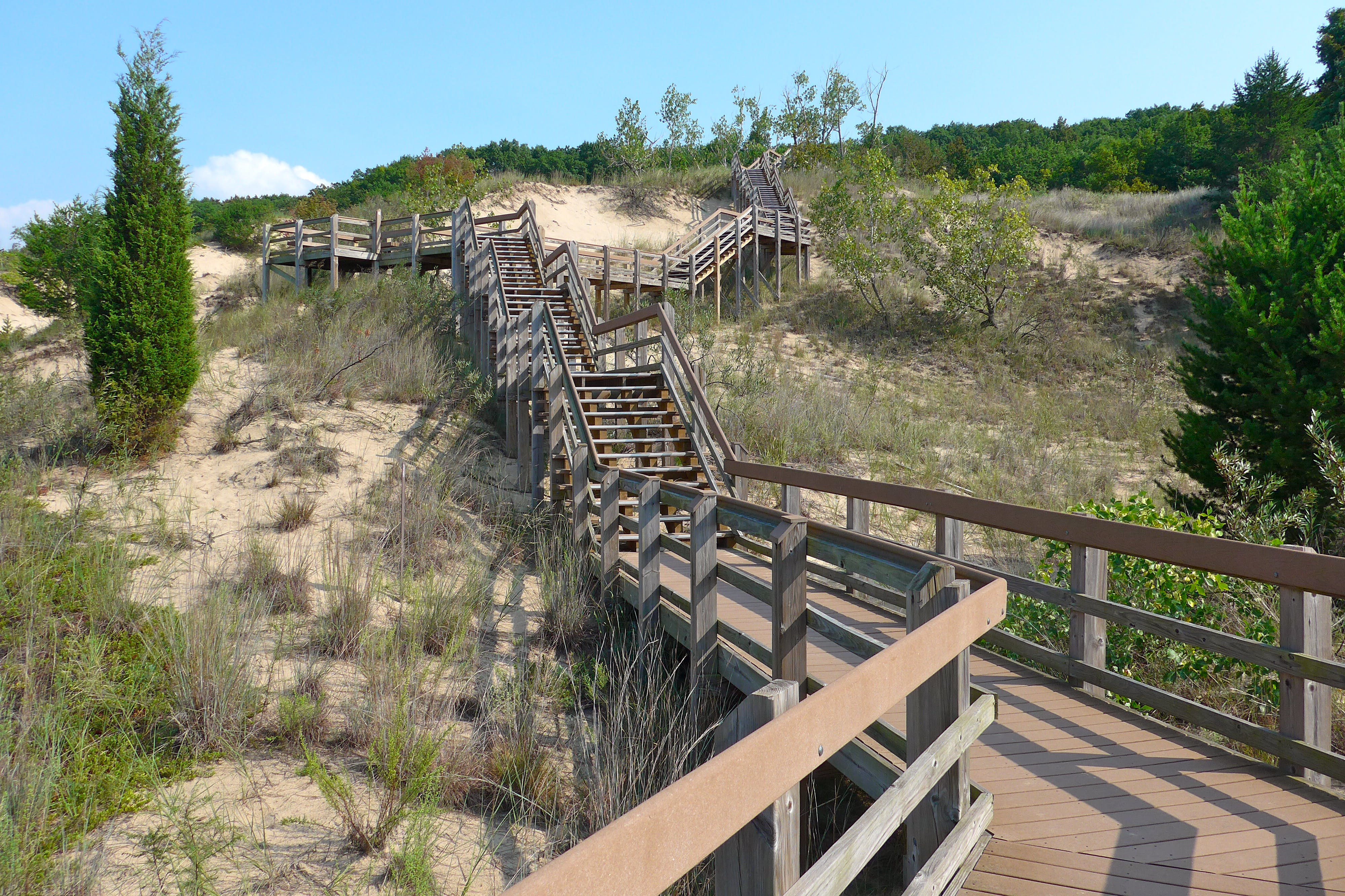 A wood boardwalk leads to the shores of Lake Michigan at the Dunewood Campgrounds in indiana