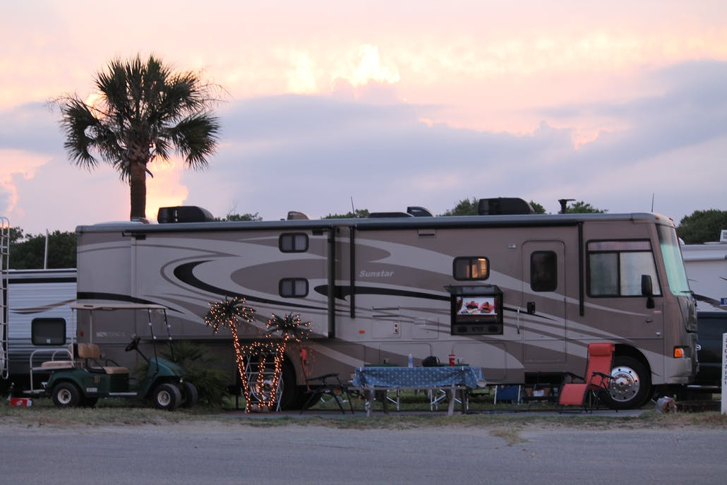myrtle beach camping at sunset with a palm tree in the background