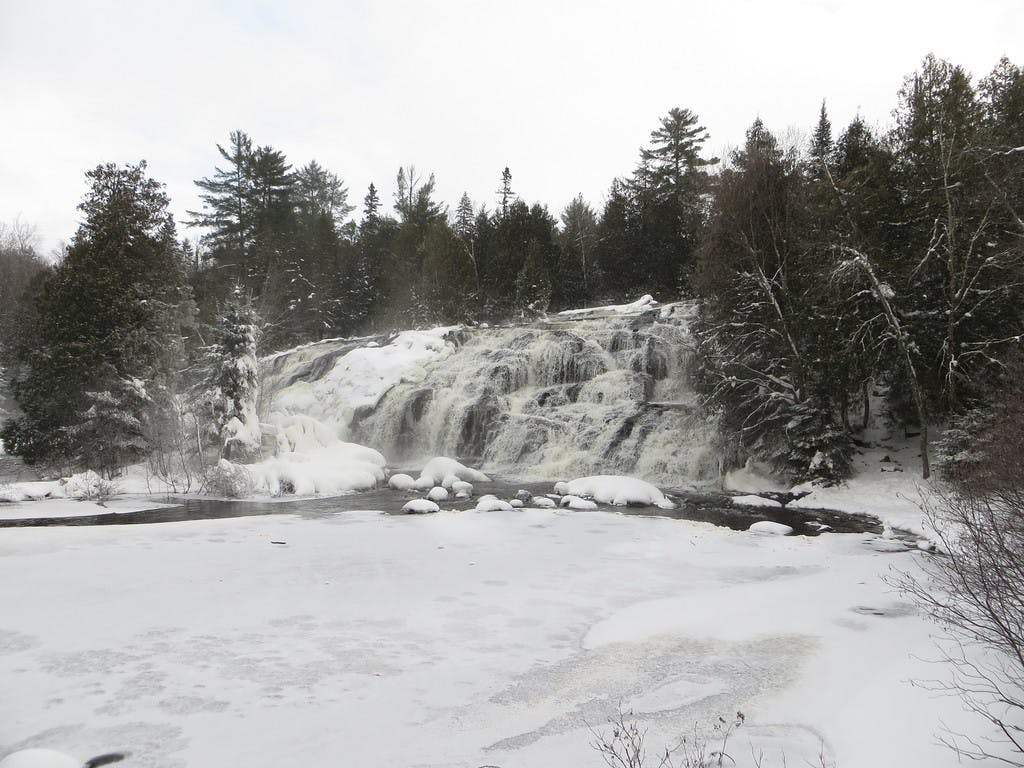 winter at a frozen bond falls