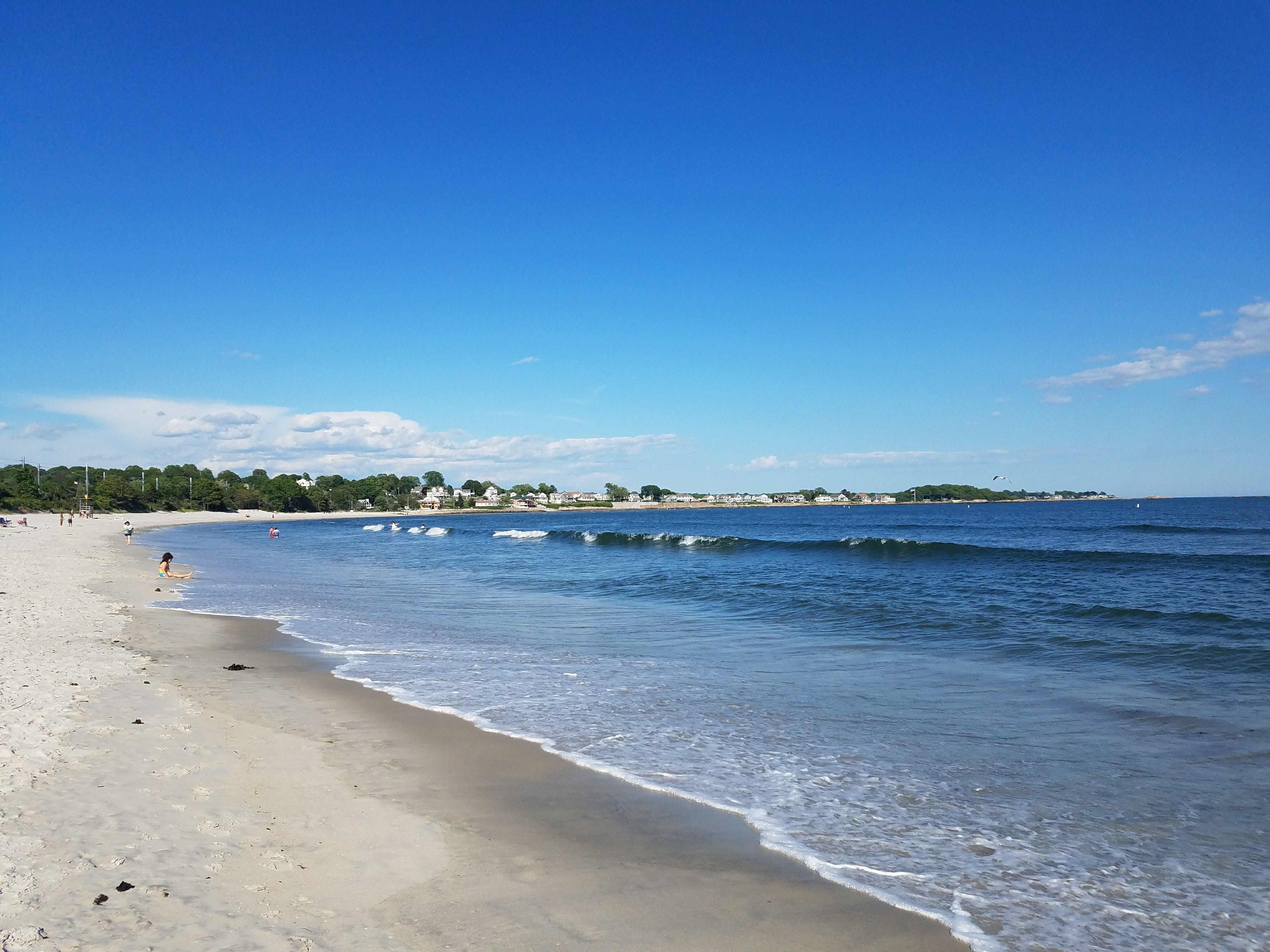 a connecticut beach on a clear, blue day