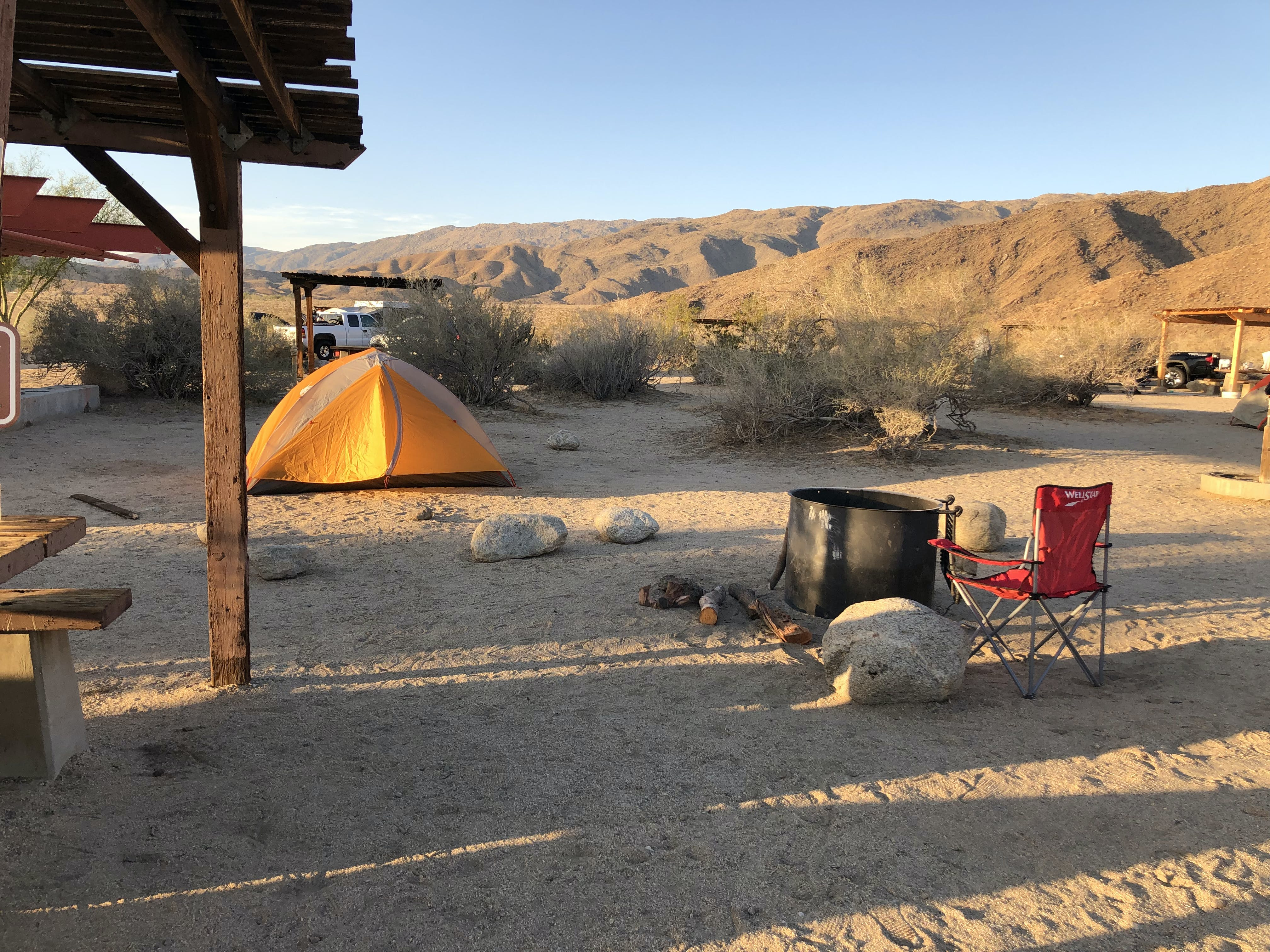tent campsite with shaded picnic tables at Borrego Palm Canyon Campground