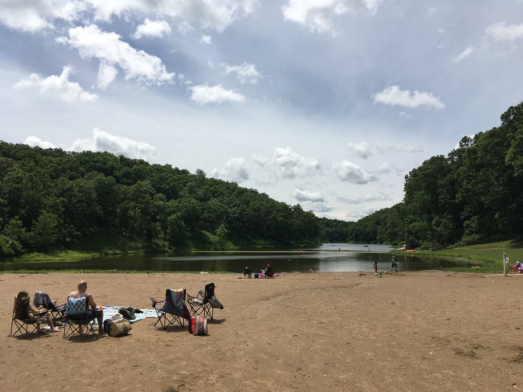 campers lounging beside the cuivre river