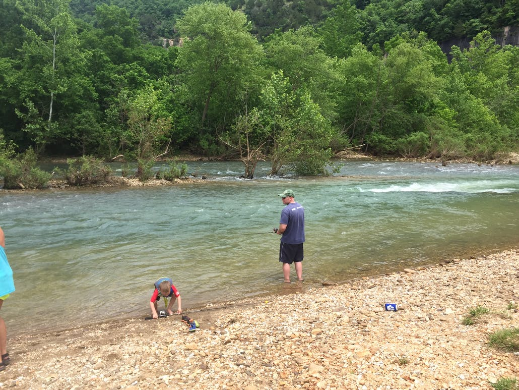 A family fishes on the shore of a river near Mill Creek Campground